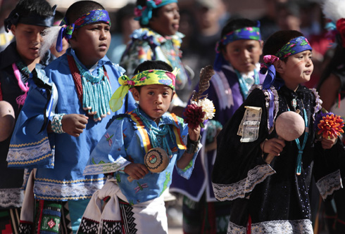 YOUNG PEOPLE TAKE PART IN FESTIVAL ON ZUNI PUEBLO INDIAN RESERVATION IN NEW MEXICO